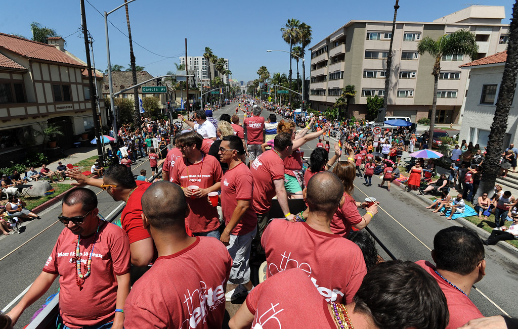 . Long Beach, Calif., -- 05-19-13- The Long Beach Gay & Lesbian Center  double decker bus during the 30th Annual Long Beach Gay and Lesbian Pride Parade along Ocean Boulevard Sunday.    Stephen Carr/  Los Angeles Newspaper Group