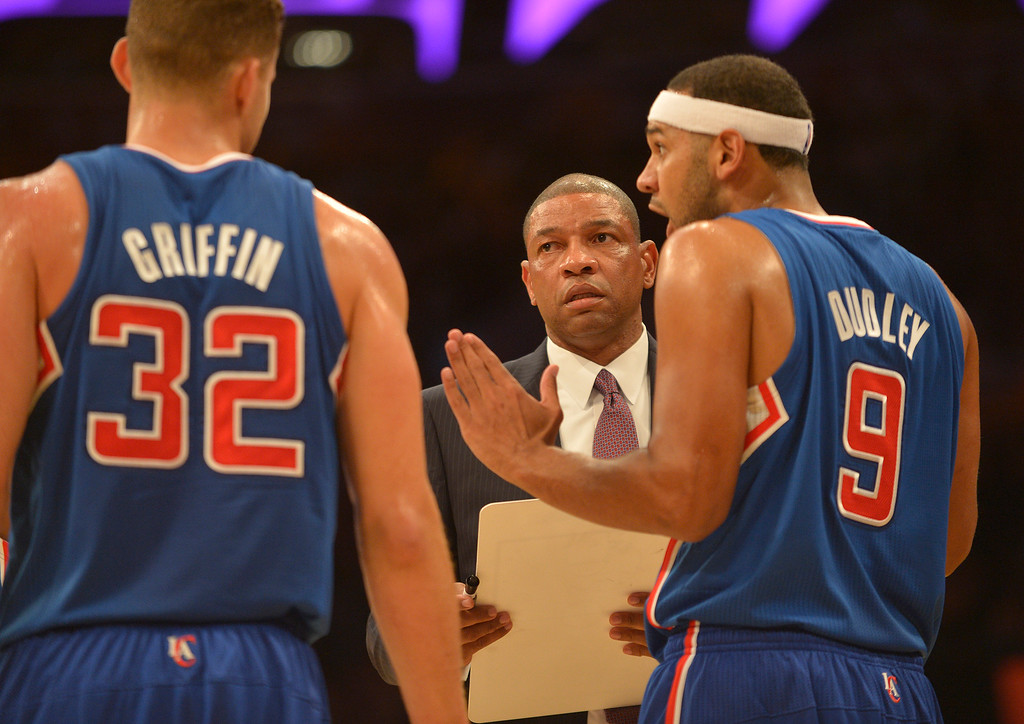 . Clippers Head Coach Doc Rivers talks with Clippers#32 Blake Griffin and Clippers#9 Jared Dudley during the first quarter of play. The Los Angeles Lakers played the Los Angeles Clippers in the opening game of the season at Staples Center. Los Angeles, CA. 10/29/2013. photo by (John McCoy/Los Angeles Daily News)