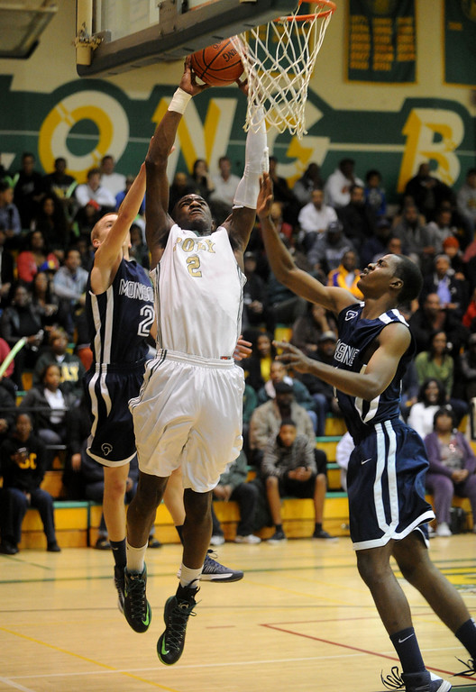 . 02-19-2012--(LANG Staff Photo by Sean Hiller)- Mayfair at Poly in the second round of the Division I-AA boys basketball playoffs Tuesday night. Mayfair\'s Mark Patterson, left, and Eze Egeonuigwe can\'t stop Poly\'s Jordan Bell from dunking first half.