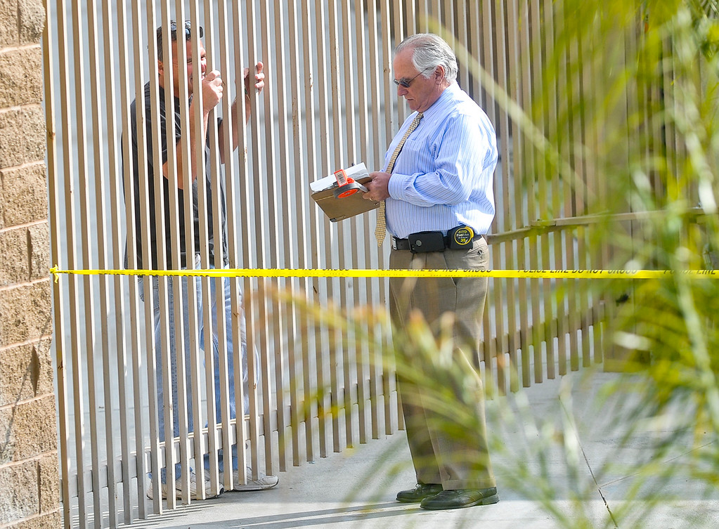 . San Bernardino police investigate the scene where the body of a woman was found near the corner of Fairway Drive and E Street in San Bernardino on Monday, Mar. 4, 2013. (Rachel Luna / Staff Photographer)