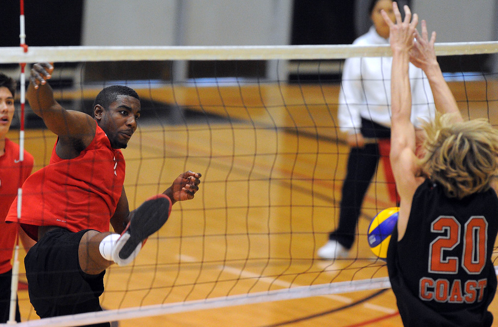 . LONG BEACH - 04/16/2013  (Photo: Scott Varley, Los Angeles Newspaper Group)  Long Beach City College defeated Orange Coast College to advance to the semifinal in the state mens volleyball playoffs. LBCC\'s Jo\'Lon Clark has his spike blocked by Ty Hutchins.