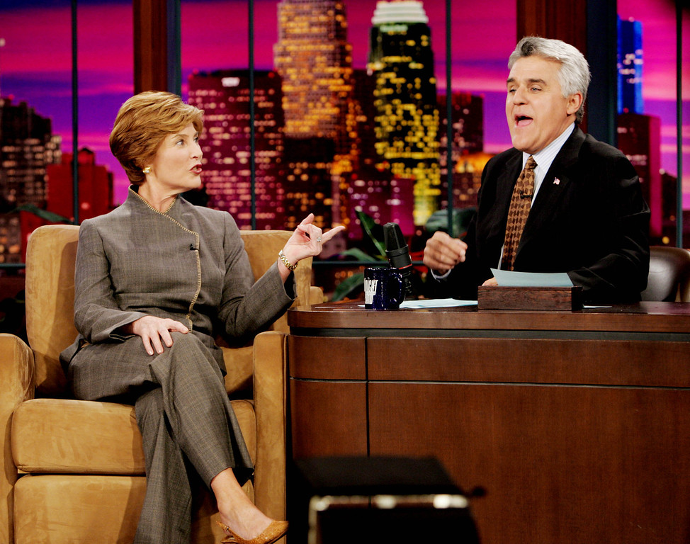 . First lady Laura Bush and host Jay Leno share a moment during the  taping of ``The Tonight Show with  Jay Leno\'\' at NBC studios in Burbank, Calif., Wednesday, Oct. 6, 2004.  (AP Photo/Reed Saxon)