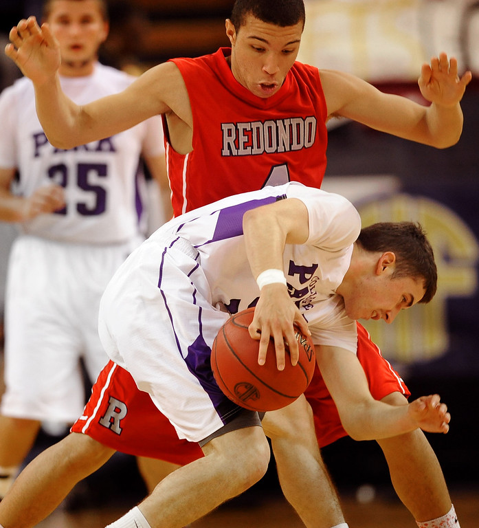 . Redondo Union High School\'s Darrien Touchstone defends Gavin Beteta of College Park High School during the Division II 2013 CIF State Basketball Championships at Sleep Train Arena, in Sacramento, Ca March 23, 2013.  Redondo won the game 54-47.(Andy Holzman/Los Angeles Daily News)