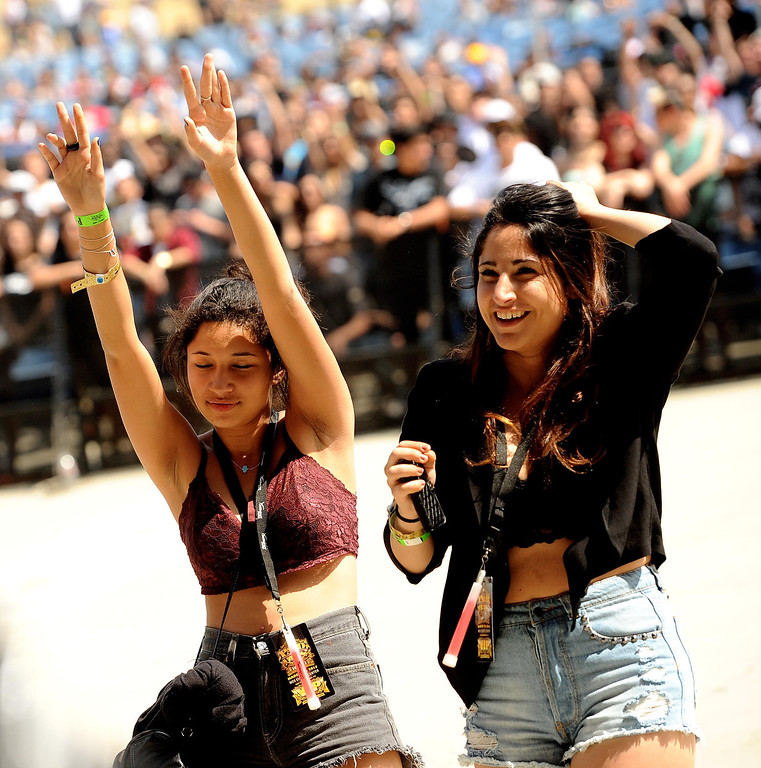 Description of . Two girls dance during the Paid Dues Independent Hip Hop Festival at San Manuel Amphitheater in Devore March 30, 2013.  GABRIEL LUIS ACOSTA/STAFF PHOTOGRAPHER.