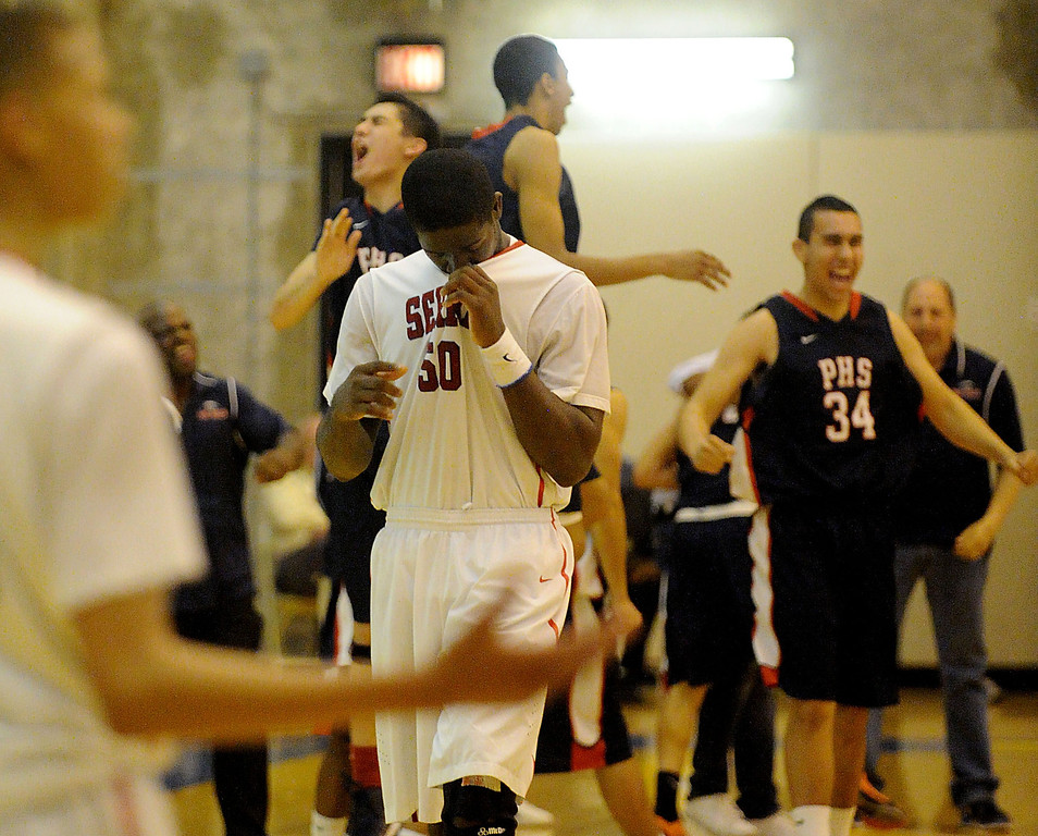 . 03-12-2013--(LANG Staff Photo by Sean Hiller)-Pacific Hills beat Serra 53-50 in Tuesday\'s boys basketball IV Southern California Regional semifinal at L.A. Southwest College. Serra\'s Emmanual Ndumanya reacts to the lost.