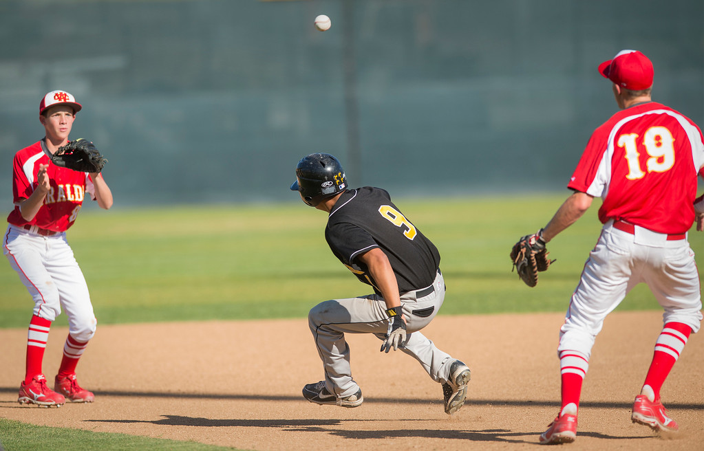 Description of . Santa Fe High's Tony Oliveras is run down in a second inning pickle after trying to steal second base vs Whittier Christian High at Biola University's field in La Mirada March 12, 2013.  (SGVN/Staff photo by Leo Jarzomb)