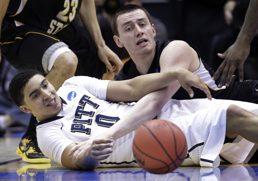 . Pittsburgh\'s James Robinson (0) and Wichita State\'s Jake White (50) go after a loose ball  in the first half during a second-round game in the NCAA college basketball tournament in Salt Lake City Thursday, March 21, 2013. (AP Photo/Rick Bowmer)