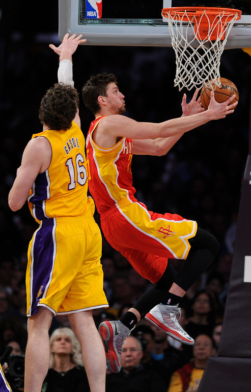 . Rockets#25 Chandler Parsons gets past Lakers#16 Pau Gasol in the 4th. The Lakers defeated the Houston Rockets in overtime 99-95 in the final home game of the year at Staples Center in Los Angeles, CA 4/17/2013(John McCoy/Staff Photographer