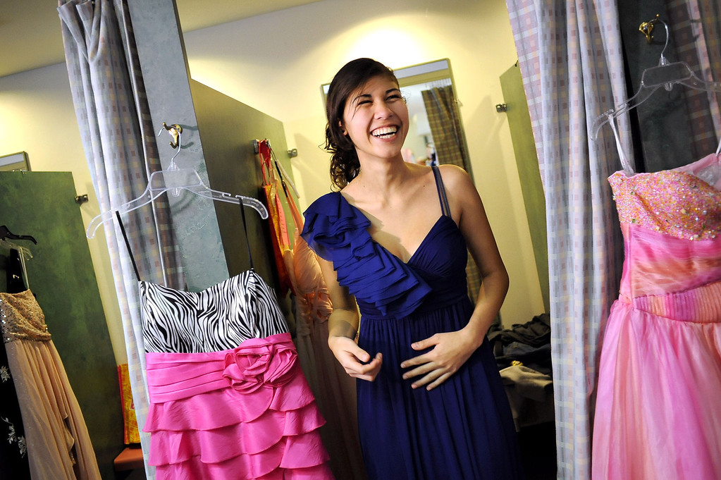 . Lizette Espino lets out a smile while trying on a prom dress during Operation School Bell\'s annual Prom Day event at the Assistance League of Los Angeles Thursday March 7, 2013.  Fifty-five homeless or needy LAUSD high school girls were able to select a dress, shoes and accessories during the event.(Andy Holzman/Los Angeles Daily News)