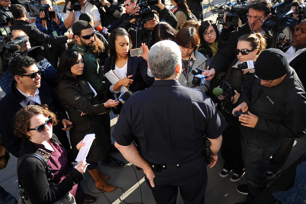 . Los Angeles police Lt. Andrew Neiman conducts a morning briefing outside the LAPD headquarters downtown Los Angeles Wednesday, February 13, 2013.(Andy Holzman/Los Angeles Daily News)