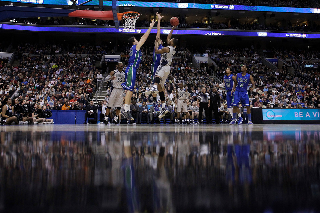 . Georgetown\'s Mikael Hopkins, front right, shoots against Florida Gulf Coast\'s Eddie Murray, left, and Chase Fieler during the second half of a second-round game of the NCAA college basketball tournament on Friday, March 22, 2013, in Philadelphia. Florida Gulf Coast won 78-68. (AP Photo/Michael Perez)