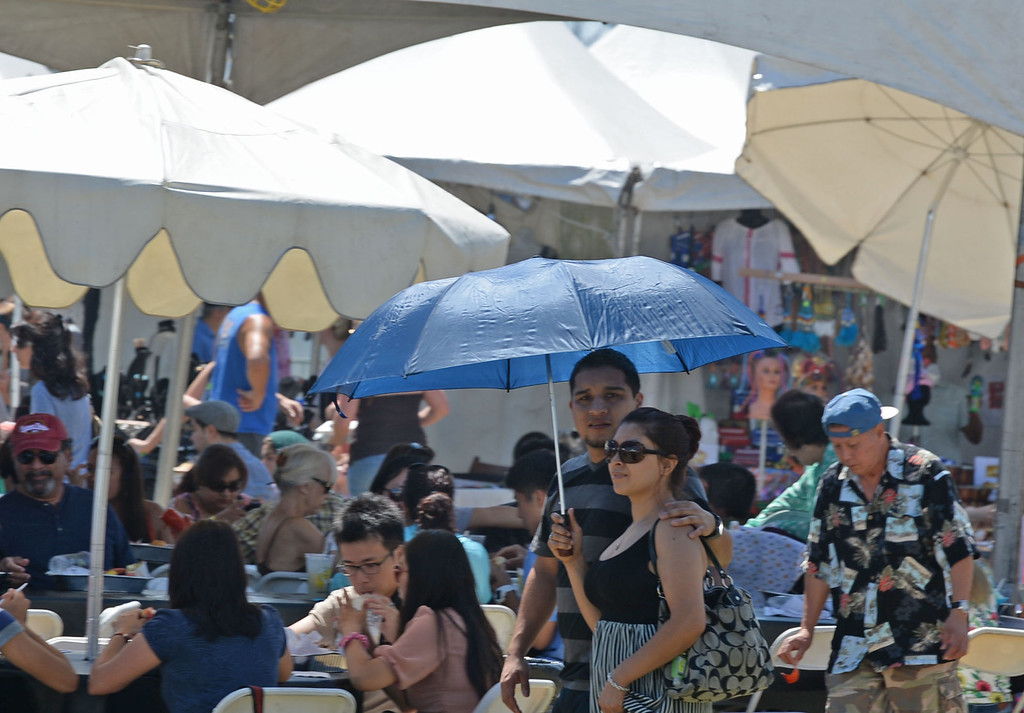 . The 17th Annual Original Lobster Festival at Rainbow Lagoon Sunday, September 08, 2013, in Long Beach.  Umbrellas, some provided and some brought, to create shade from the warm weekend temperatures. Photo by Steve McCrank / Daily Breeze