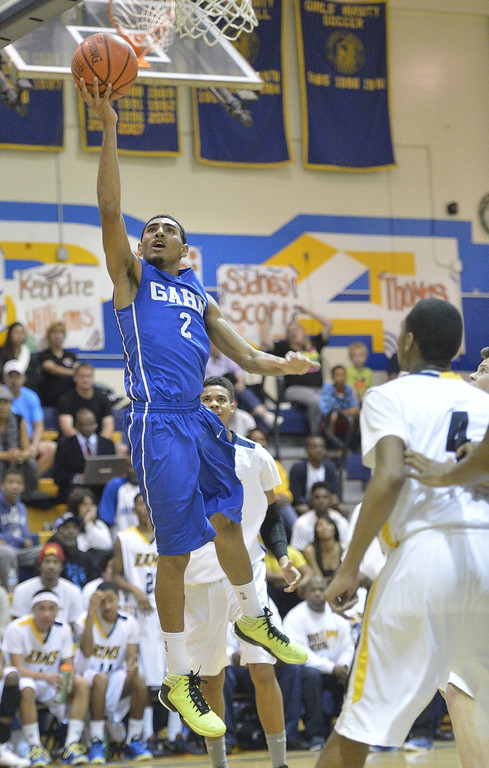 . LONG BEACH, CALIF. USA -- Gahr\'s Malachi Hoosein (2) takes a shot against Millikan during their CIF-SS Divison 1-A playoff game in Long Beach on February 15, 2013. Millikan defeated Gahr, 74 to 64. Photo by Jeff Gritchen / Los Angeles Newspaper Group