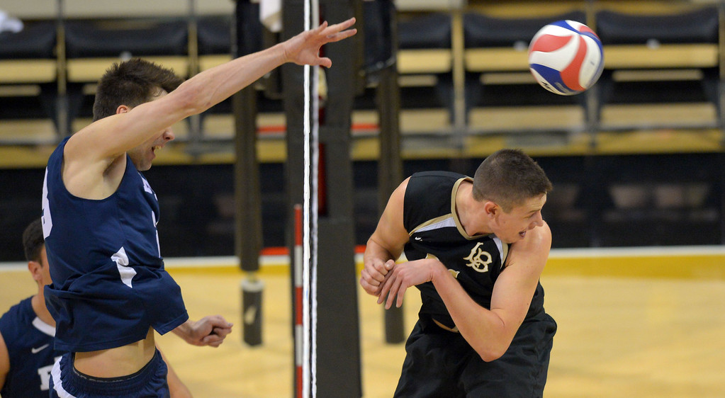 . LBSU\'s Connor Olbright ducks from BYU\'s Michael Hatch\'s hit in Long Beach, CA on Friday, March 7, 2014 #2 BYU vs #3 Long Beach State men\'s volleyball at Walter Pyramid. (Photo by Scott Varley, Daily Breeze)