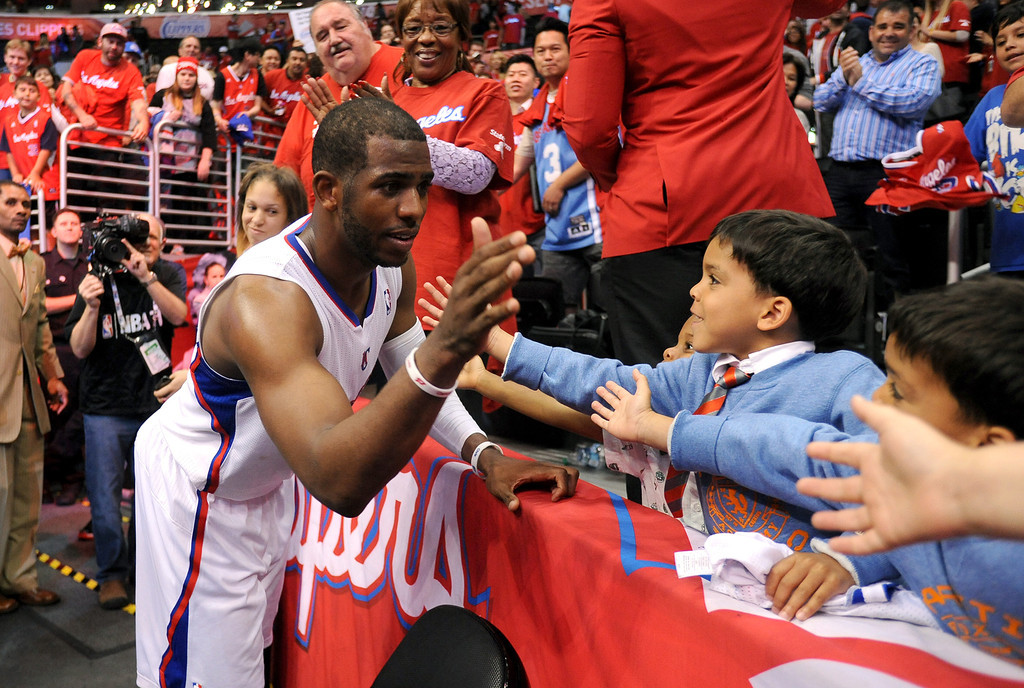 . Clippers guard Chris Paul high fives youngsters following game 2 against the Memphis Grizzlies in the 2013 NBA Western Conference Playoffs April 22, 2013 in Los Angeles, CA.(Andy Holzman/Staff Photographer)