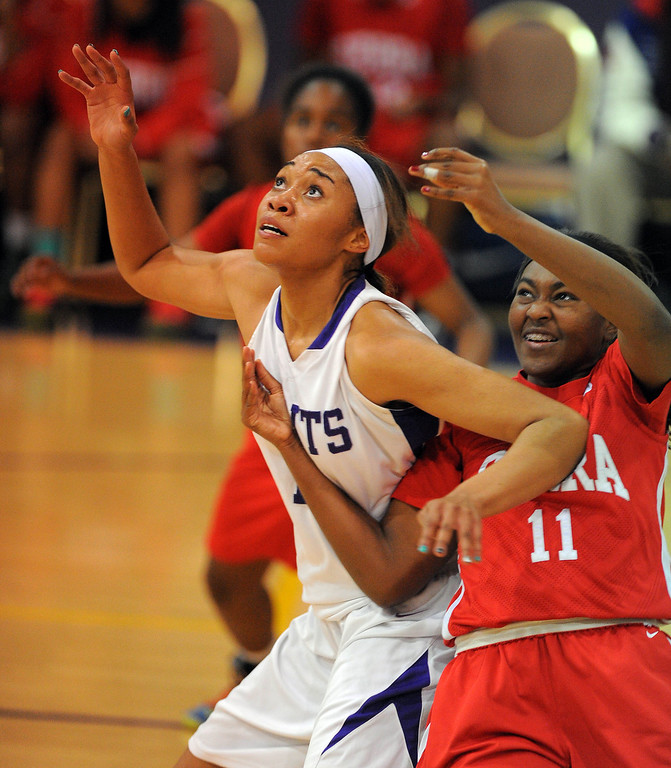 . LONG BEACH - 02/20/13 - (Photo: Scott Varley, Los Angeles Newspaper Group)  Serra and St. Anthony meet in the Quarterfinals of the Division 4AA CIF-SS girls basketball playoffs. St. Anthony\'s Kendall Cooper, left, is fouled by Denisha Hamilton as she looks for an inbound pass.