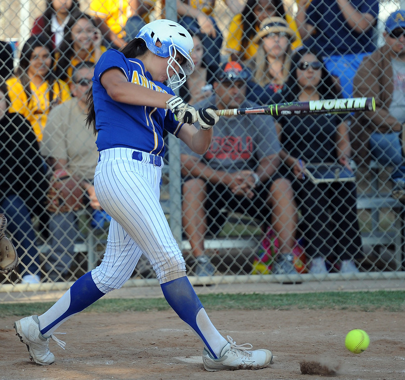 Description of . Bishop Amat's Amanda Sanchez watches her RBI single as Eryn Sustayta (not pictured) scores the go ahead run in the sixth inning of a prep softball game against Santiago at Bishop Amat High School on Wednesday, March 27, 2013 in La Puente, Calif. Bishop Amat won 5-3.  (Keith Birmingham Pasadena Star-News)