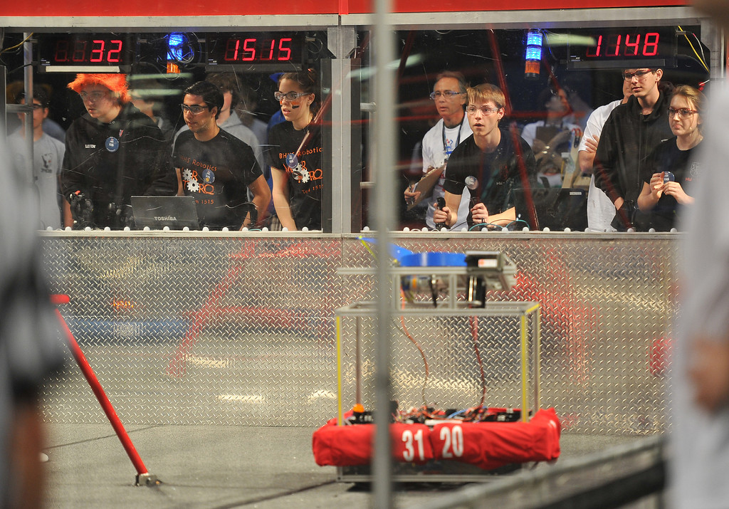 . 3/22/13 - Connor Basich, right,  of Harvard Westlake High School on the controls during the robotic competition on Friday morning. More than 1,500 high school students from California, Hawaii and Chile are competing in the 22nd FIRST Robotics Los Angeles Regional Competition at the Long Beach Arena.This years robotic task is throwing discs for points. Photo by Brittany Murray / Staff Photographer