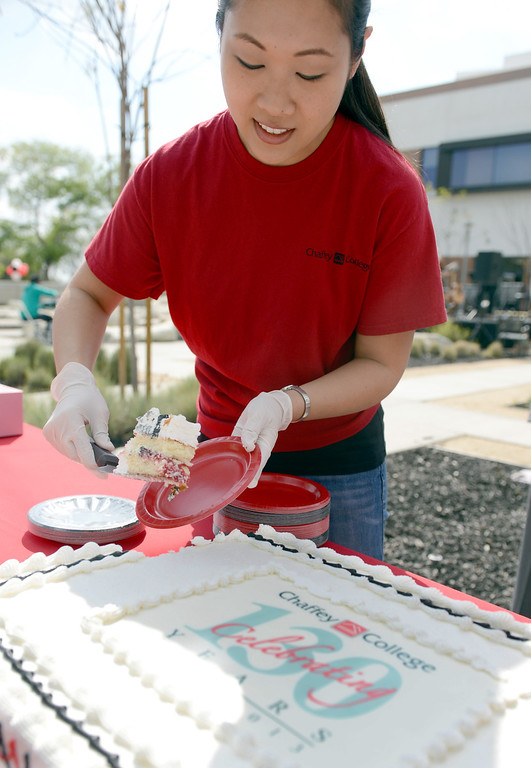 """Description of . Joanie Lin, 31 Nursing student, helps pass out cake at Chaffey College """"130th"""" anniversary celebration in Rancho Cucamonga March 9, 2013.(Thomas R. Cordova/Staff Photographer)"""