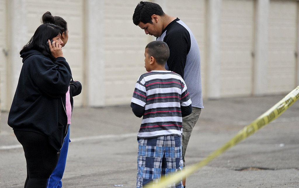 Description of . Police investigate the scene of a double homicide on the 300 block of Orchid Lane in Pomonaon Saturday, April 13, 2013. Two teenagers, a 16-year-old and 13-year-old boy, were fatally shot and one adult male was critically wounded, according to authorities. (Rachel Luna / Staff Photographer)