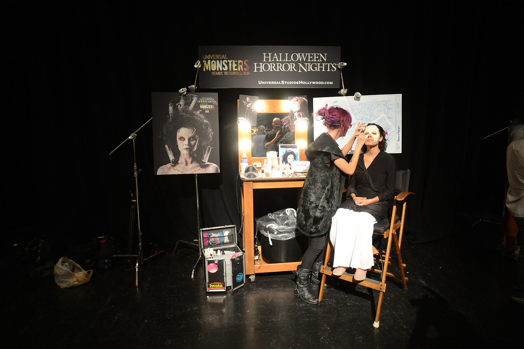 . Makeup artist Laney Chantal turns Britney Huerta in to a futuristic bride of Frankenstein  during a press preview of Universal Studios \'Halloween Horror Nights� at Universal Studios Tuesday, August 27, 2013. \'Halloween Horror Nights� begins on Friday, September 20, and continues on 21 select nights through November 2, 2013. (Hans Gutknecht/Los Angeles Daily News)