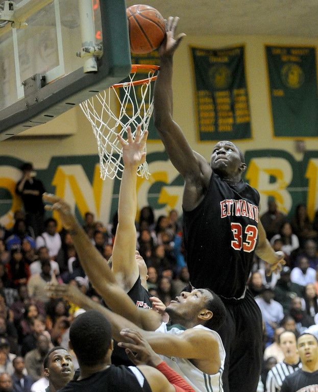 . 02-26-2012--(LANG Staff Photo by Sean Hiller)-Etiwanda beat Long Beach Poly 59-55 in Tuesday\'s CIF Southern Section Division 1AA semifinal boys basketball game at Long Beach Poly High School. Etiwanda\'s Tim Myles (33) soars over Poly\'s Roschon Prince (1) to stop him from scoring.