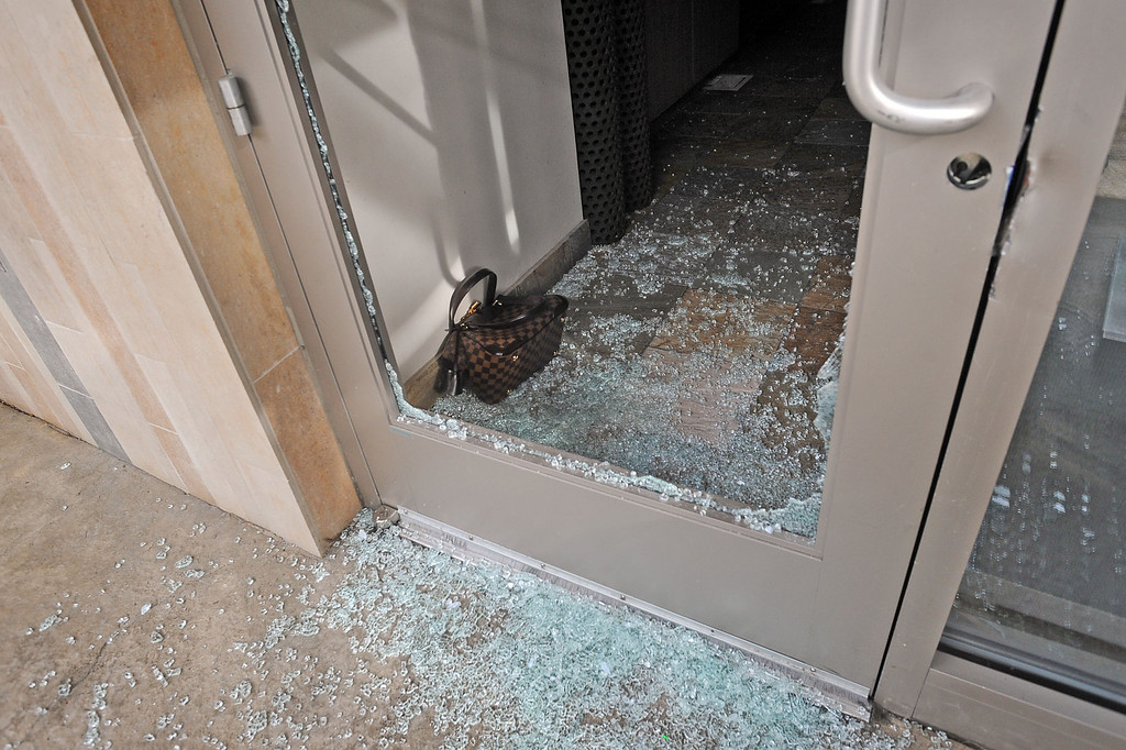 . A purse sits in broken glass in the Neiman Marcus Cafe early Thursday at the Westfield Topanga mall in Canoga Park, CA March 7, 2013.  Three men broke the window, cut through a security gate and stole purses from the store.(Andy Holzman/Los Angeles Daily News)