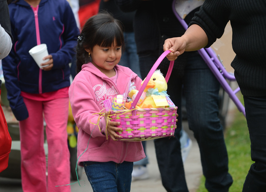 . The Long Beach Rescue Mission served Easter meals and gave out Easter baskets to the children Sunday morning. The mission has been doing so since 1972 and provides food, clothing, shelter and guidance for the homeless and poor.  Children walk away with happy faces after receiving their Easter baskets. 20130331 Photo by Steve McCrank / Staff Photographer