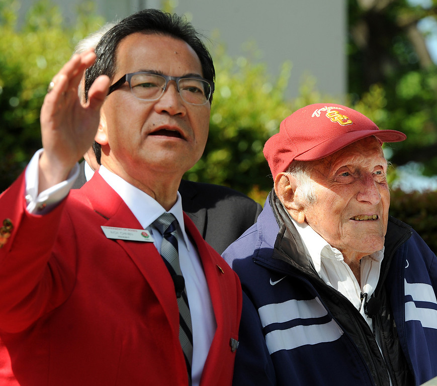 Description of . Tournament President Richard L. Chinen, left, with Louis Zamperini, who attended USC, was selected 2015 Tournament of Roses Grand Marshal. Olympian and World War II prisoner of war, Louis Zamperini, a true American Hero who survived excessive hardships. (Photo by Walt Mancini/Pasadena Star-News)