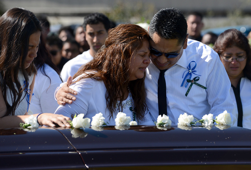 Description of . 0315_IDB-L-AGUILAR-01-JCM (Jennifer Cappuccio Maher/Staff Photographer) Argelia and Raul Aguilar mourn at the casket for their son, Ivan Arturo Aguilar, during funeral services Thursday, March 14, 2013, at Oakdale Memorial Park in Glendora. Aguilar was hit and killed by a car while riding his bike on campus at Cal Poly Pomona in Pomona.