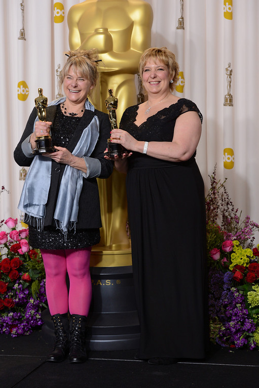 ". Julie Dartnell and Lisa Westcott accept the award for best makeup and hairstyling for ""Les Miserables\"" backstage at the 85th Academy Awards at the Dolby Theatre in Los Angeles, California on Sunday Feb. 24, 2013 ( David Crane, staff photographer)"