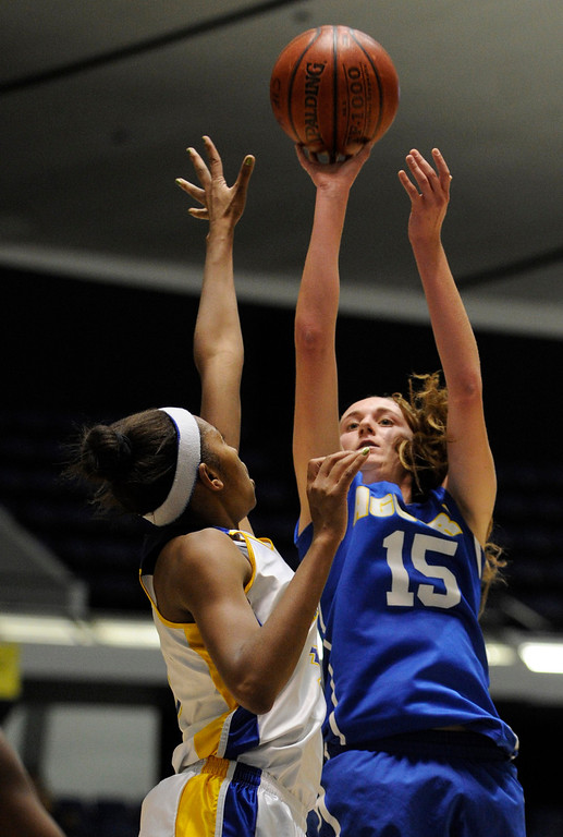 . Agoura #15 Kim Jacobs shoots over Gahr #10 Ra\'Vyn Bowser. Agoura defeated Gahr 60-39 in the CIF-SS Division III-AAA Girls Basketball Championship at the Anaheim Convention Center in Anaheim, CA 2/23/2013(John McCoy/Staff Photographer)