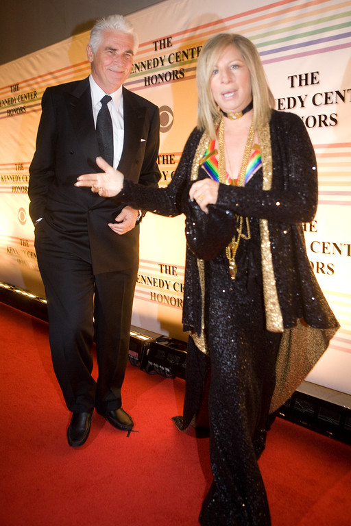 . Singer Barbra Streisand arrives with actor James Brolin at the Kennedy Center for the Kennedy Center Honors on December 7, 2008 in Washington, DC. In its 31st year, the Kennedy Center Honors recognizes honorees for their lifetime contributions to American culture through the performing arts. (Photo by Brendan Hoffman/Getty Images)
