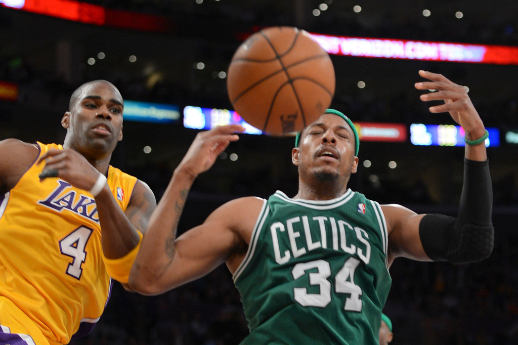 . Lakers Antawn Jamison and Celtics\' Paul Pierce go for a rebound during second half action at Staples Wednesday. Lakers defeated the Celtics 113-99.  Photo by David Crane/Staff Photographer