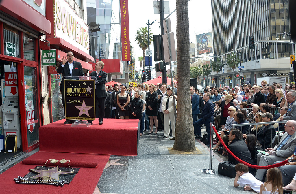 . American illusionists and entertainers Penn Jillette (L) and Teller speak as they are honored with a star on the Hollywood Walk of Fame on April 05, 2013 in Hollywood, California. AFP PHOTO/JOE KLAMAR        (Photo credit should read JOE KLAMAR/AFP/Getty Images)