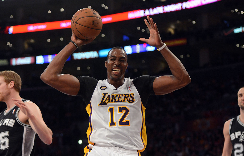 . The Lakers\'  Dwight Howard #12 reacts during game four of their NBA Western Conference playoffs against the Spurs at the Staples Center Saturday, April 28, 2013. The Spurs beat the Lakers 120-89. (Hans Gutknecht/Staff Photographer)