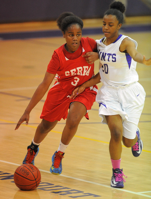 . LONG BEACH - 02/20/13 - (Photo: Scott Varley, Los Angeles Newspaper Group)  Serra and St. Anthony meet in the Quarterfinals of the Division 4AA CIF-SS girls basketball playoffs. Serra won 58-45. Serra\'s Siera Thompson drives down the court as she\'s guarded by Nia Williams.