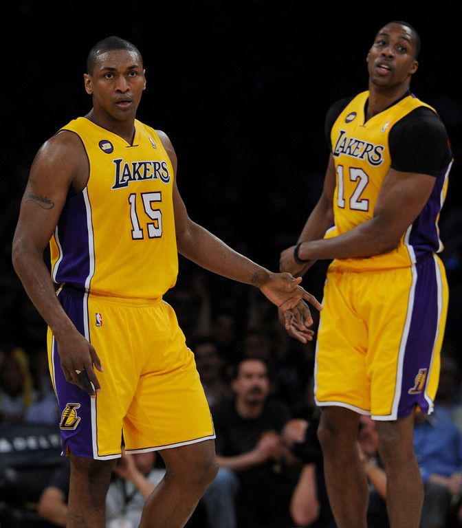 . Lakers#15 Metta World Peace is congratulated by Lakers#12 Dwight Howard after he hit a 3 pointer in the first half. The Lakers played the New Orleans Hornets at Staples Center in Los Angeles CA 4/9/2013(John McCoy/Staff Photographer
