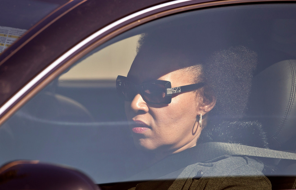 . Daughter Zenani Dlamini arrives by car at the Mediclinic Heart Hospital where former South African President Nelson Mandela is being treated, in Pretoria, South Africa Wednesday, June 12, 2013. (AP Photo/Ben Curtis)