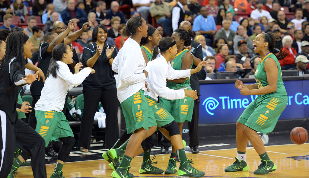 . Poly players celebrate as the game ends at Sleep Train Arena in Sacramento, CA on Saturday, March 29, 2014. Long Beach Poly vs Salesian in the CIF Open Div girls basketball state final. 2nd half. Poly won 70-52. (Photo by Scott Varley, Daily Breeze)