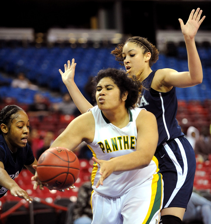 . Sierra Canyon\'s Cheyanne Wallace and Jorden Sneed double team Angelina Mapa of Pinewood during the 2013 CIF State Basketball Championships at the Sleep Train Arena, in Sacramento, Ca March 22, 2013.  Sierra Canyon won the game 47-33.(Andy Holzman/Los Angeles Daily News)