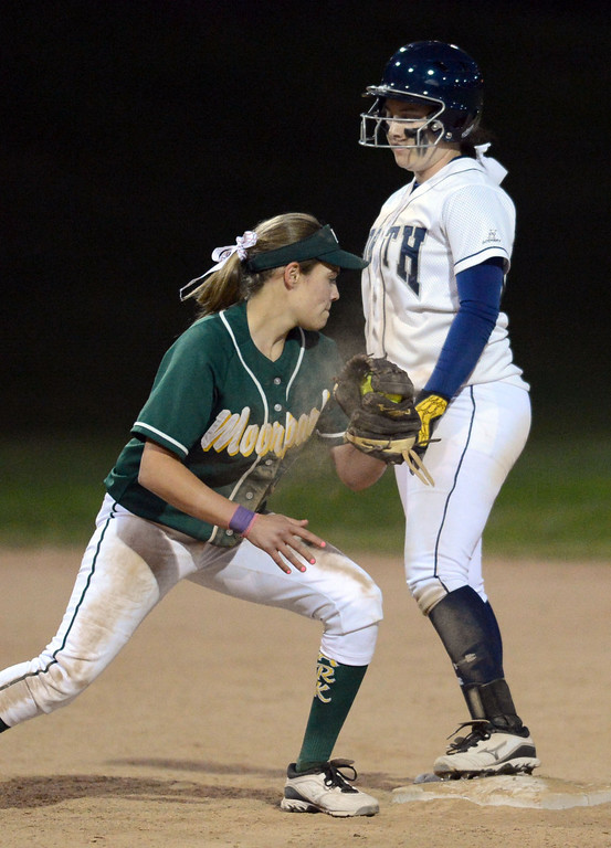 . North\'s Amanda Sandoval (00) gets to the base ahead of a throw to Moorpark\'s Madison Fleming (6) in a pool play softball game of the TNT Tournament at Wilson Park in Torrance. 20130321 Photo by Steve McCrank / Staff Photographer