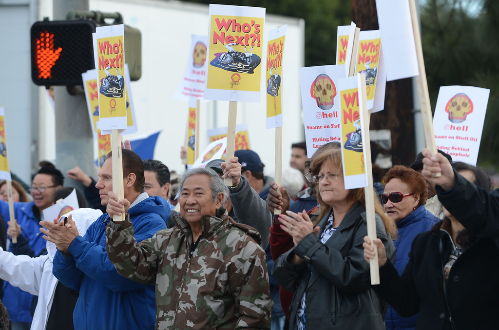 . Residents of the Carousel Tract neighborhood in Carson staged a protest against Shell Oil Friday by marching with signs from Dolphin Park to a Shell facility on Wilmington Avenue. 20130308 Photo by Steve McCrank / Staff Photographer