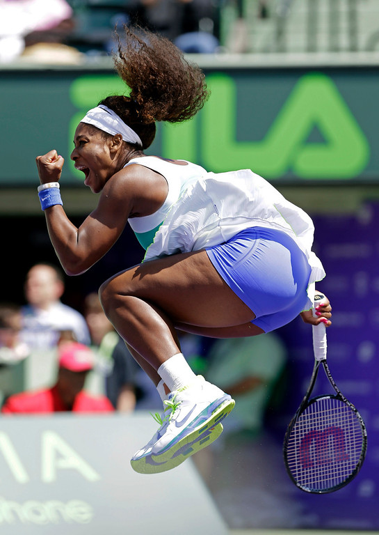 Description of . Serena Williams celebrates her 6-3, 7-6(5) win against Li Na, of China, during the Sony Open tennis tournament in Key Biscayne, Fla.,  Tuesday, March 26, 2013. (AP Photo/Alan Diaz)