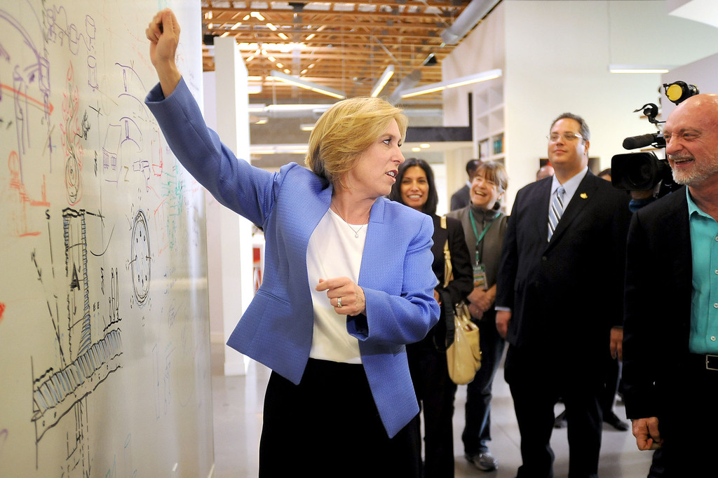 . Los Angeles mayoral candidate Wendy Greuel shows how she could use a large white board while making an appearance at WET Design in Los Angeles March 6, 2013.  Greuel and Eric Garcetti are now campaigning for a May runoff.(Andy Holzman/Los Angeles Daily News)