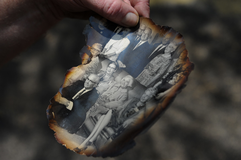 . Lake Hughes resident Jonathan Pehrson holds a singed  old photograph found on Newview Drive in Lake Hughes from the Powerhouse Fire, Sunday, June 2, 2013. (Michael Owen Baker/Staff Photographer)