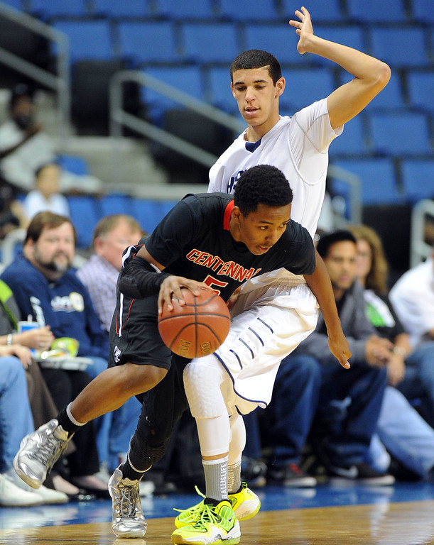 . Centennial\'s Khalil Ahmad drives around CH\'s Lonzo Ball at Citizens Business Bank Arena in Ontario, CA on Saturday, March 22, 2014. Chino Hills vs Centennial in the CIF boys Div 1 regional final. 1st half. Photo by Scott Varley, Daily Breeze)