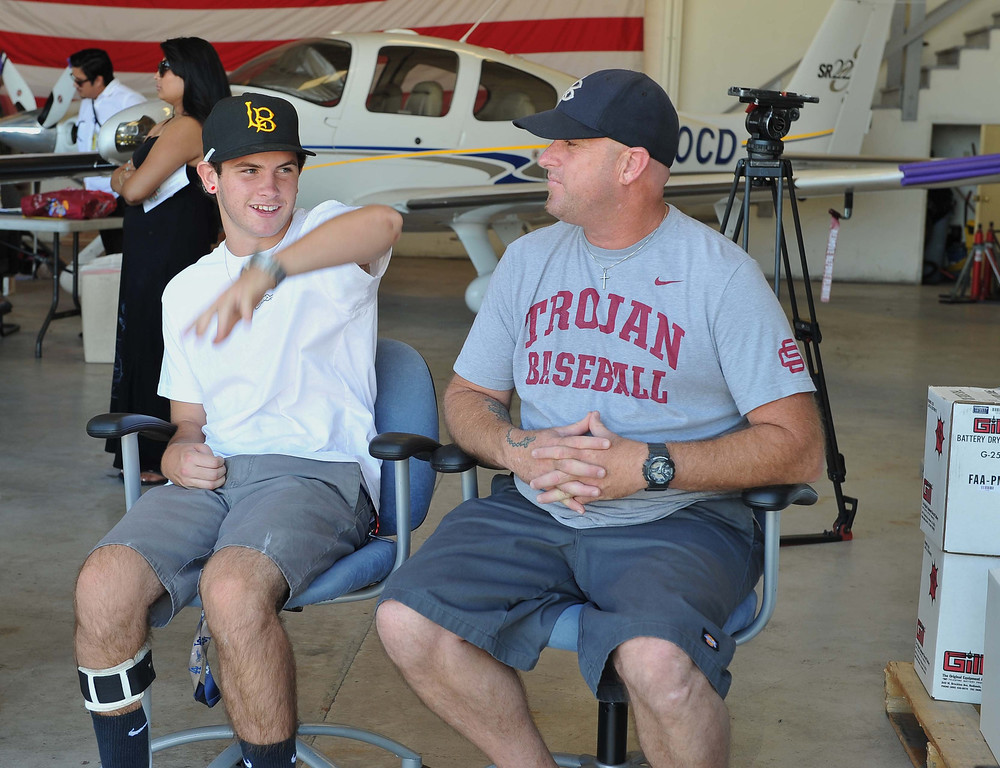 . 8/21/13 - L-R Kadin Nicolau talks with his dad Kevin Nicolau before they go flying on Wednesday afternoon. Pediatric rehabilitation patients from Miller Children�s Hospital Long Beach got experience their first �Discovery Flight� at the California Flight Center. After some training from the pilots the kids got to actually pilot the plane on their own. The program which uses volunteer pilots has taken 125 kids in the air. Photo by Brittany Murray, Press Telegram