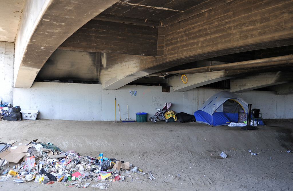 . 8/5/13 - This homeless encampment at the 710 Freeway and Artesia Boulevard is home to roughly 23 people according to one of the residents. Many of the people living here were evacutated from the encampments south of Willow along the LA Riverbed. The area is not as populated as years past but those facing chronic homelessness can still be found living under the bridges and in encampments. The county cleaned out the area in March 2013 and has stayed on top of the brush clearance and clean-up. Photo by Brittany Murray / Staff Photographer