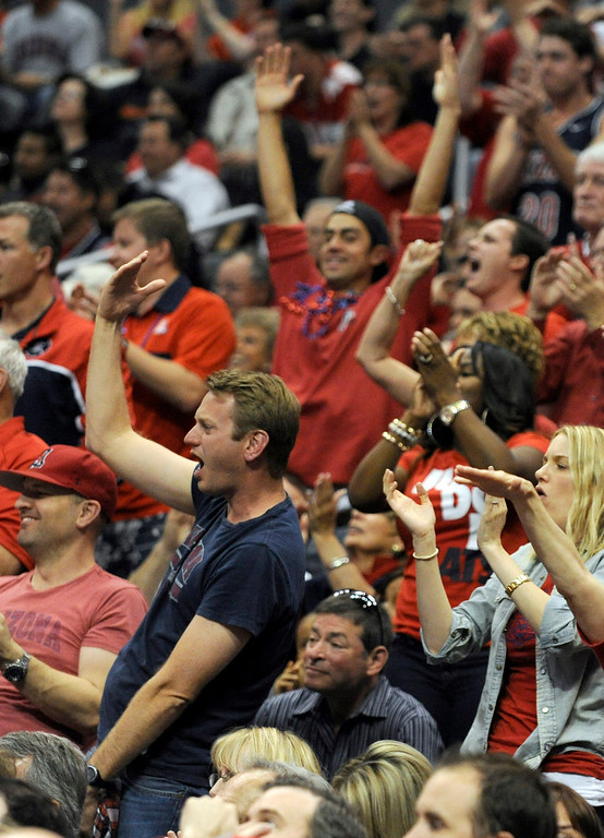 . Arizona fans cheer in the first half. Arizona and Ohio State met at Staples Center for the West Regional of the NCAA Division I Men\'s Basketball Championships. Los Angeles,CA 3/28/2013(John McCoy/Staff Photographer